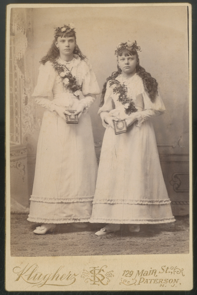 Cabinet Photograph of Two Girls with Flower Crowns and Sashes each holding a Book