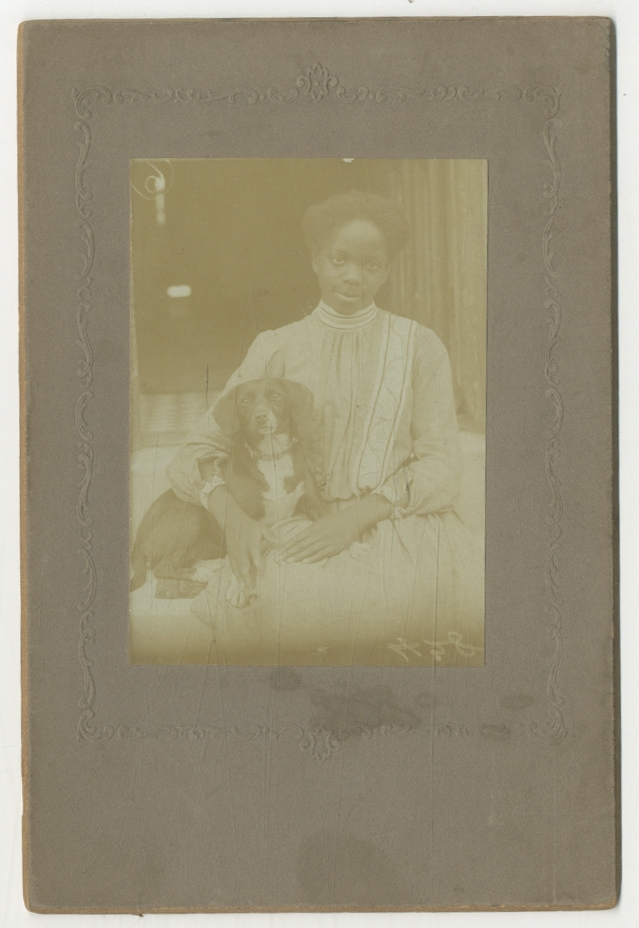 (Cabinet photograph): Young African-American Woman with a Dog (c. 1895)