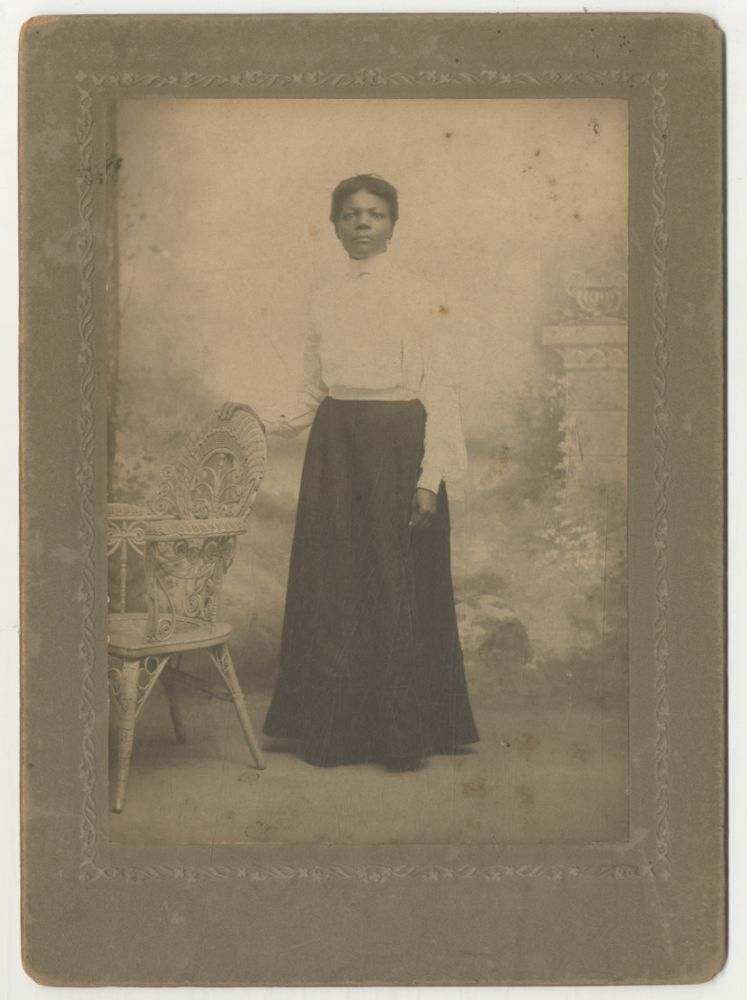 (Cabinet photograph): African-American Woman Standing with her hand on a wicker chair (circa 1890)